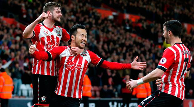 Maya Yoshida is swamped by teammates after giving Southampton the lead. Photo: REUTERS