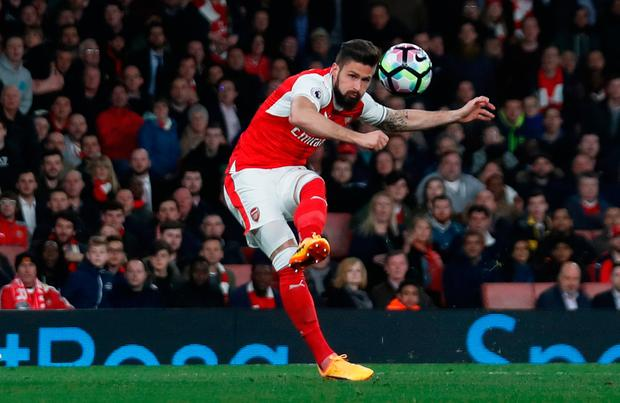 Olivier Giroud curls in Arsenal's third goal. Photo: REUTERS