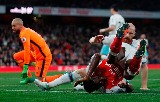 Arsenal's Danny Welbeck has a shot blocked by West Ham United's James Collins. Photo: REUTERS
