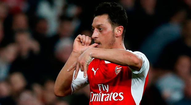 Mesut Ozil celebrates giving Arsenal the lead at the Emirates. Photo: GETTY