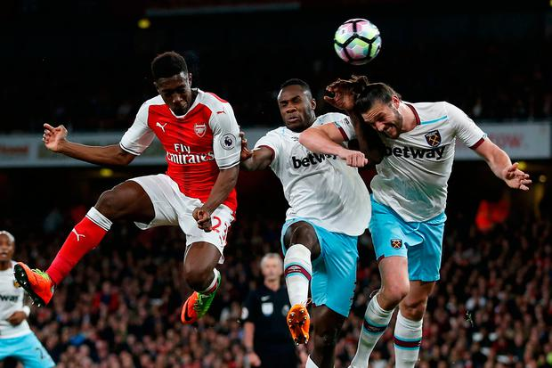 Danny Welbeck (L) beats West Ham United's Michail Antonio and Andy Carroll (R) to the ball but has his header saved during the London derby at the Emirates. Photo: AFP/Getty Images