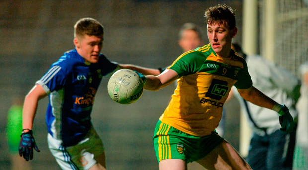 Donegal's Michael Langan pursued by Cavan's Eoin Sommerville. Photo: Sportsfile
