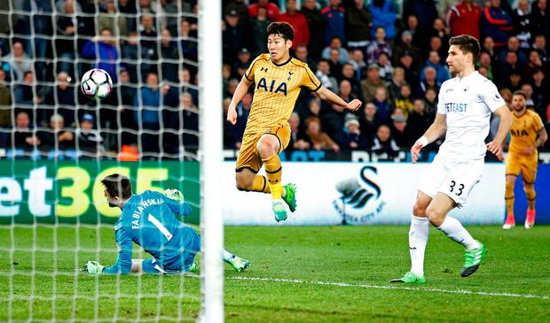 Tottenham's Son Heung-Min scores to put them into the lead against Swansea during last night's comeback. Photo: REUTERS