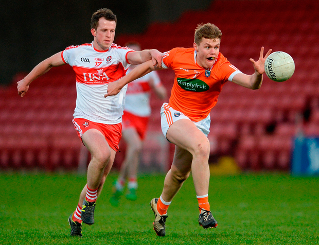 Oisin O'Neill of Armagh in action against Ruairi McElwee of Derry. Photo: Sportsfile