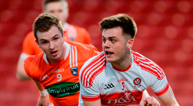 Derry's Oisin Duffy is pursued by Armagh's Jack Rafferty. Photo: Sportsfile