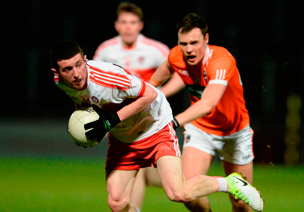 Derry's Ternan Flanagan in action against Caolan McConville of Armagh. Photo: Sportsfile