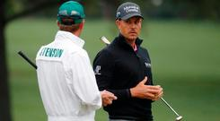 Henrik Stenson chats with his caddie Gareth Bryn Lord during Wednesday practice rounds for the 2017 Masters. Photo: REUTERS/Brian Snyder