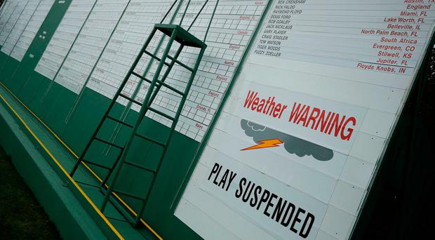 A sign advises that approaching weather has suspended play during Wednesday practice rounds for the 2017 Masters. Photo: REUTERS/Jonathan Ernst