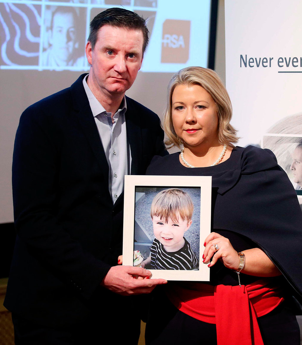 Gillian and Ronan Treacy with a photo of their son Ciaran