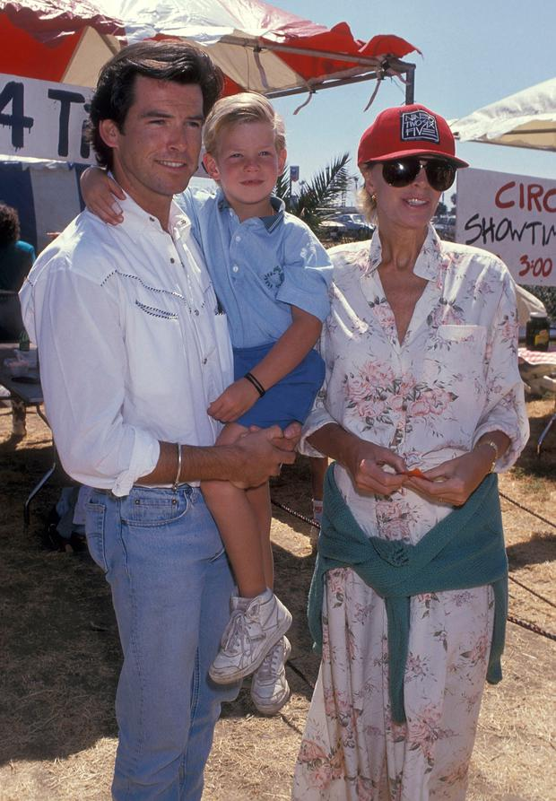 Actor Pierce Brosnan, wife Cassandra Harris and son Sean Brosnan attend the Eighth Annual Malibu Kiwanis Chili Cook-off Carnival and Fair on September 2, 1989 at the Civic Center Area in Malibu, California. (Photo by Ron Galella, Ltd./WireImage)