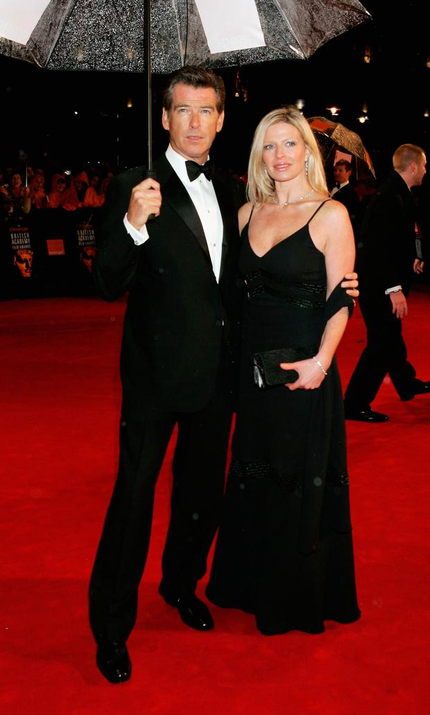 Actor Pierce Pierce Brosnan (L) and Charlotte Brosnan arrive at The Orange British Academy Film Awards (BAFTAs) at the Odeon Leicester Square on February 19, 2006 in London, England. (Photo by Chris Jackson/Getty Images)