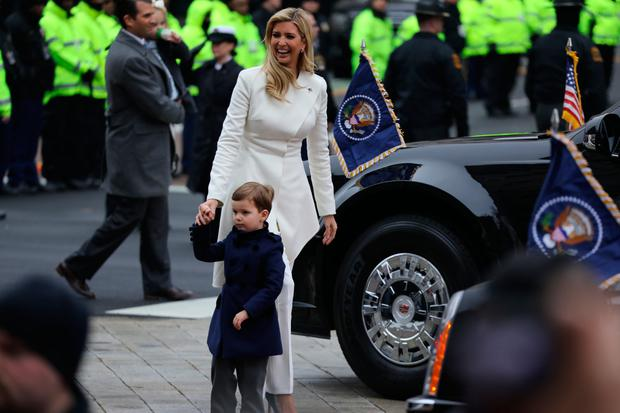 Ivanka Trump walks with her son Joseph during the inaugural parade in Washington, DC, on January 20, 2017. =