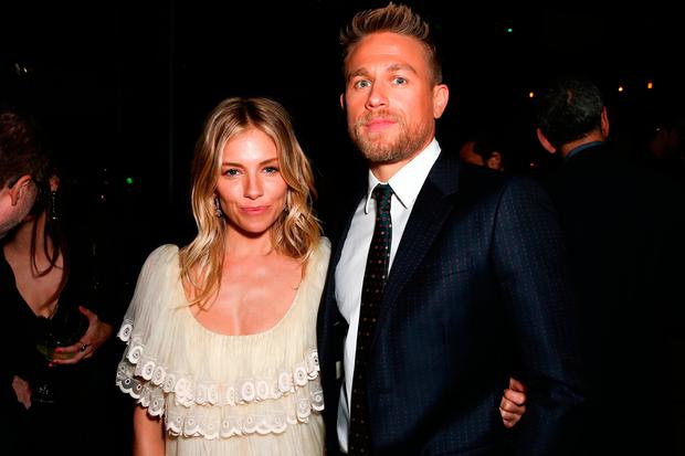 Actors Sienna Miller (L) and Charlie Hunnam attend the after party for the premiere of Amazon Studios' 'The Lost City Of Z' at Le Jardin on April 5, 2017 in Hollywood, California. (Photo by Rich Fury/Getty Images)