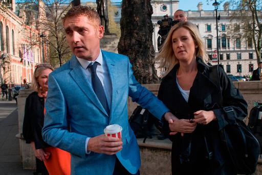 Jon Platt arrives at the Supreme Court in central London with his wife Sally where the Court will rule on the much-anticipated legal case on an unauthorised holiday during school term time. Stefan Rousseau/PA Wire