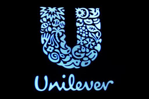 FILE PHOTO: The company logo for Unilever is displayed on a screen on the floor of the New York Stock Exchange (NYSE) in New York, US, February 17, 2017. REUTERS/Brendan McDermid/File Photo