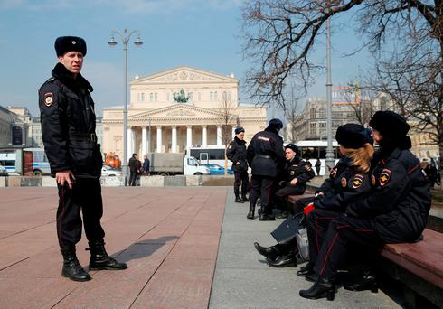 Police officers take a rest from patrolling the streets following the St. Petersburg metro blast that took place on April 3, in Moscow, Russia April 6, 2017. REUTERS/Maxim Shemetov