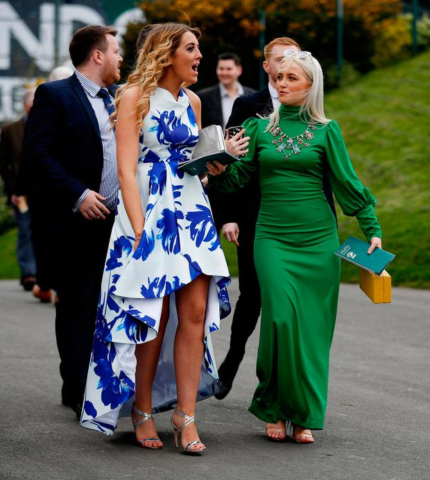 Racegoer arrive at Aintree Racecourse