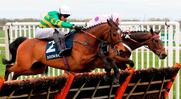 Barry Geraghty on board Defi Du Seuil wins the Doom Bar Anniversary 4 Year Old Juvnile Hurdle during day one of the Randox Health Grand National Festival at Aintree