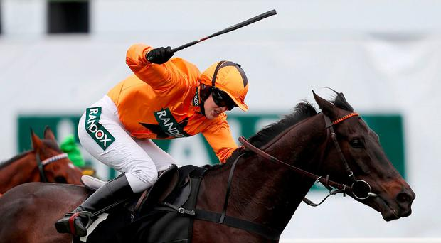 Tea For Two ridden by Jockey Lizzie Kelly on the way to winning the Betway Bowl Chase during day one of the Randox Health Grand National Festival at Aintree
