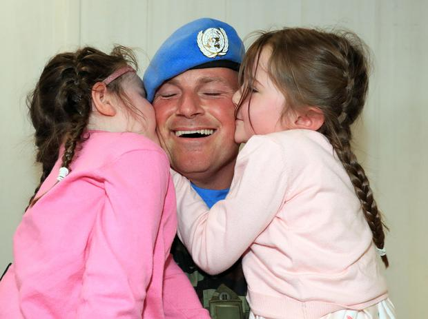 Pte. Peter O'Connor from Roscommon is welcomed home by his daughters, Katie (5) and Eva (4) when 130 Irish troops from the 54th Infantry Group, United Nations Disengagement Observer Force (UNDOF), returned to Terminal One, Dublin Airport this morning , following a six month deployment to the Golan Heights. Photo: Collins Dublin.