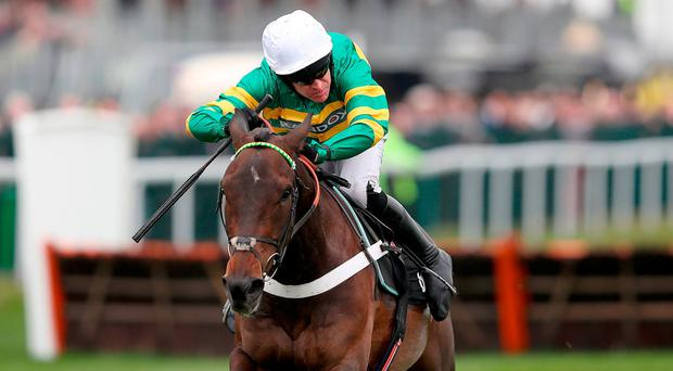 Buveur D'air ridden by Jockey Barry Geraghty on their way to winning the Betway Aintree Hurdle during day one of the Randox Health Grand National Festival at Aintree