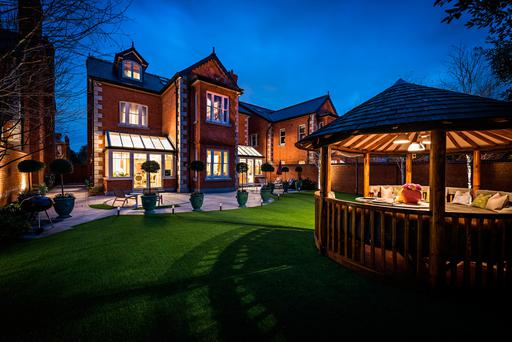 The rear of the property features a gazebo/summer house for al fresco dining and evening drinks