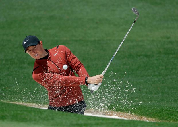 Rory McIlroy hits from a bunker on the second hole during the first round of the Masters