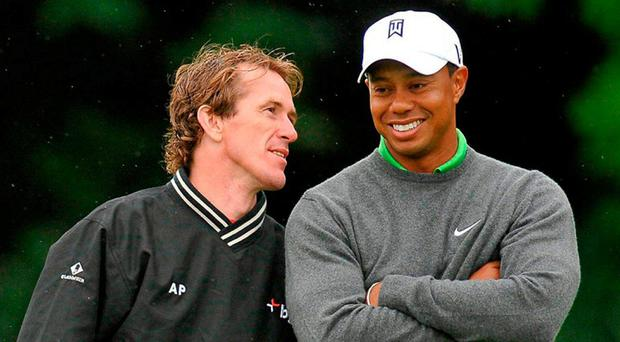 Tony McCoy and Tiger Woods, right, share a joke as Mick Fitzgerald prepares to tee off at the 9th tee box during the JP McManus Invitational Pro-Am back in July, 2010. Photo: Diarmuid Greene / SPORTSFILE