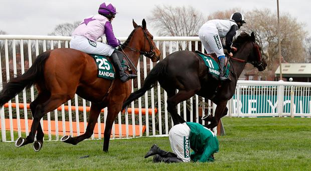 Katie Walsh is unseated from Distime during the Foxhunters Chase at Aintree. Photo: REUTERS