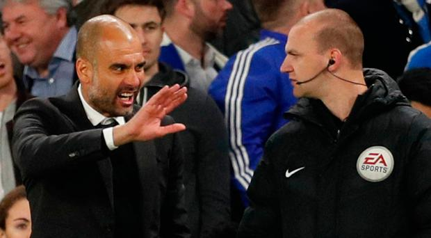 Pep Guardiola makes his feelings known to fourth official Robert Madley during the match at Stamford Bridge. Photo: REUTERS