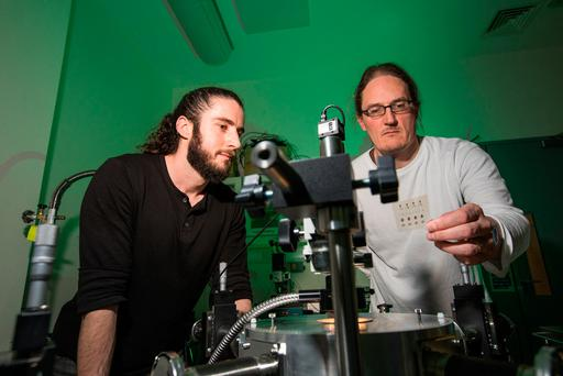 Prof Jonathan Coleman, right, investigator in Amber and Trinity's School of Physics, with PhD student Adam Kelly. A major breakthrough in smart printed electronics means milk cartons could send messages to your phone warning milk is about to go out of date. Photo: Naoise Culhane
