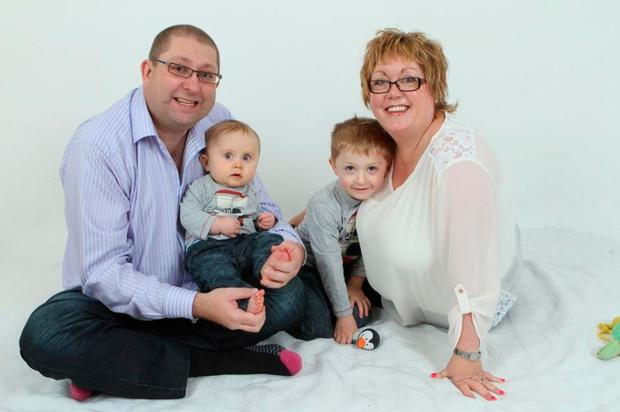 Margaret with husband Robert and sons Micheal and Ruairi