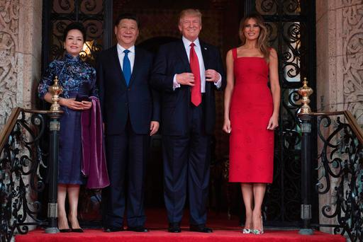 US First Lady Melania Trump (R) and President Donald Trump (2nd R) pose with Chinese President Xi Jinping (2nd L) and his wife Peng Liyuan (L) upon their arrival to the Mar-a-Lago estate in West Palm Beach, Florida, on April 6, 2017. / AFP PHOTO / JIM WATSONJIM WATSON/AFP/Getty Images