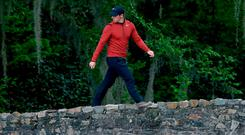 Rory McIlroy strides across Nelson Bridge at Augusta on his way to an even par opening round. Photo: David Cannon/Getty Images