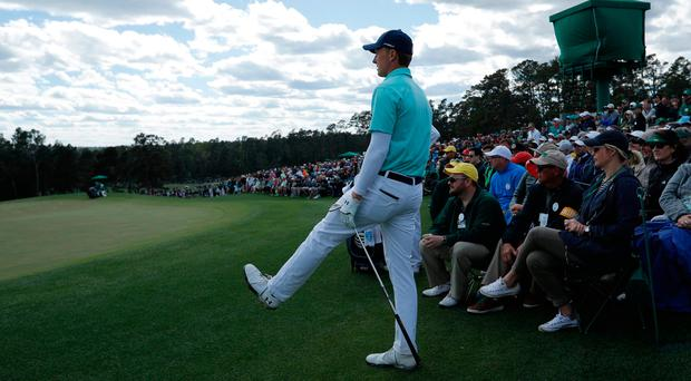 Jordan Spieth of the U.S. watches his chip shot onto the 18th green in first round play during the 2017 Masters. Photo: REUTERS/Mike Segar