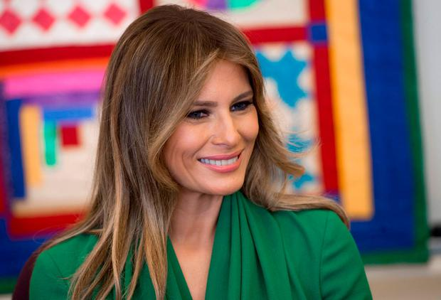 US First Lady Melania Trump talks with students during a visit with Jordan's Queen Rania to the Excel Academy Public Charter School in Washington, DC, April 5, 2017. / AFP PHOTO / SAUL LOEBSAUL LOEB/AFP/Getty Images