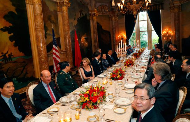 President Donald Trump and Chinese President Xi Jinping, with their wives, first lady Melania Trump and Chinese first lady Peng Liyuan are seated at the center, during a dinner at Mar-a-Lago, Thursday, April 6, 2017, in Palm Beach, Fla. (AP Photo/Alex Brandon)