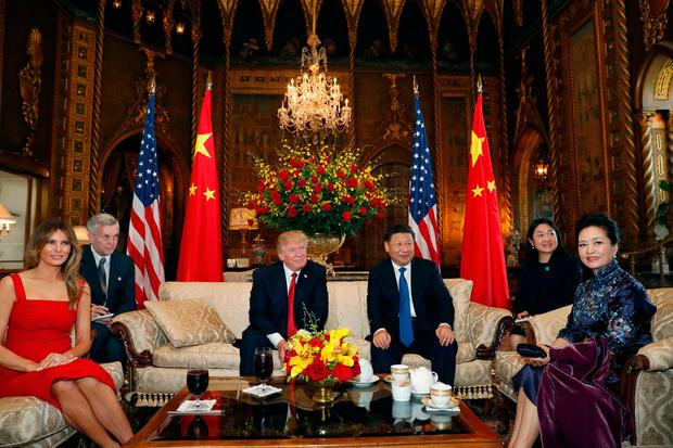 President Donald Trump and Chinese President Xi Jinping, sit with their wives, first lady Melania Trump, left, and Chinese first lady Peng Liyuan, right, before a meeting at Mar-a-Lago, Thursday, April 6, 2017, in Palm Beach, Fla. (AP Photo/Alex Brandon)