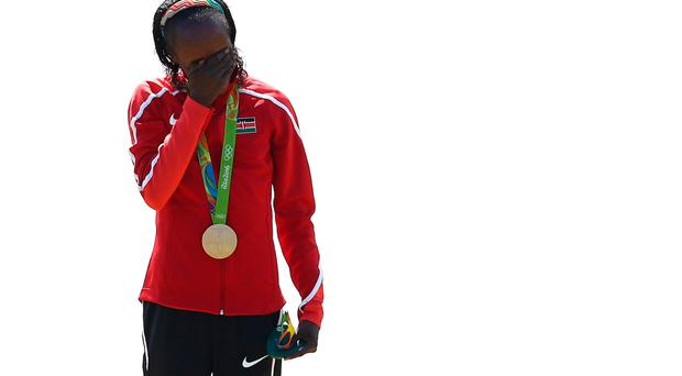 Gold medalist Jemima Jelagat Sumgong of Kenya reacts during the medal ceremony in Rio