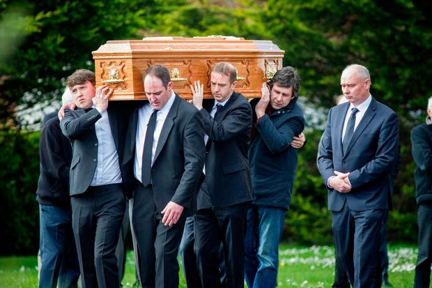 The coffin of Anthony O'Mahony (74) is shouldered from St Peter and Pauls church in Ballyduff following his funeral mass. Pic:Mark Condren