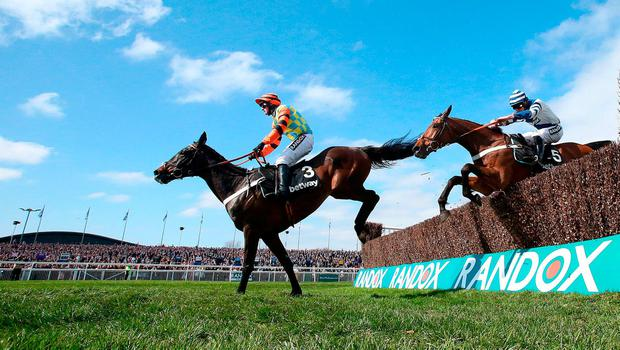 Might Bite ridden by jockey Nico de Boinville on the way to winning the Betway Mildmay Novices' Chase on Ladies Day of the Randox Health Grand National Festival at Aintree