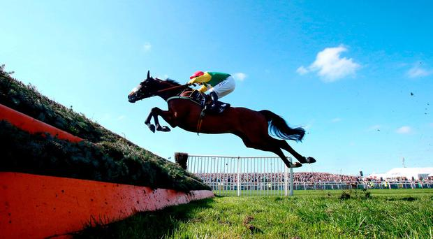 Fox Norton ridden by jockey Robbie Power on the way to winning the JLT Melling Chase on Ladies Day of the Randox Health Grand National Festival at Aintree