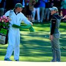 Danny Willett of England talks with caddie Jonathan Smart before making a triple bogey on the first hole during the second round of the 2017 Masters. (Photo by Harry How/Getty Images)