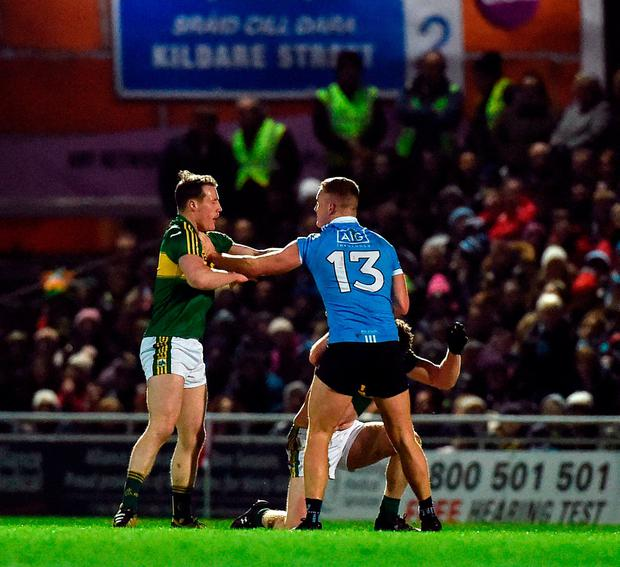 Ciaran Kilkenny of Dublin tussles off the ball with Mark Griffin, left, and Tadhg Morley of Kerry during the Allianz Football League Division 1 Round 5 match between Kerry and Dublin at Austin Stack Park in Tralee, Co Kerry. Photo by Diarmuid Greene/Sportsfile