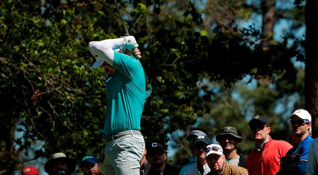 Justin Rose of England reacts to his tee shot off the fourth tee in second round play during the 2017 Masters golf tournament at Augusta