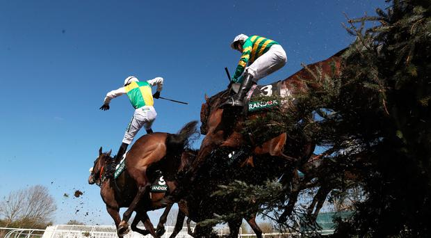 Will Kennedy (left) falls from Katachenko during the Topham Handicap Chase at Aintree yesterday. Photo: PA