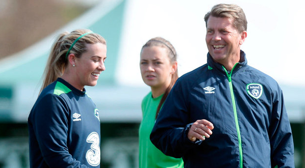 Ireland coach Colin Bell talks to Harriet Scott during training with the women's senior squad in Abbotstown, Dublin Photo: Caroline Quinn