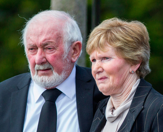 Anthony O'Mahony's brother Seamas and his wife Margaret follow the coffin Photo: Mark Condren
