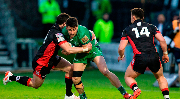 Tiernan O'Halloran of Connacht is tackled by Phil Burleigh of Edinburgh Rugby. Photo: Sportsfile