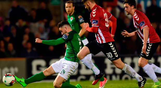 Cork's Sean Maguire stretches to score his side's third goal in their victory over Derry. Photo: Sportsfile